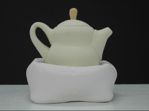 Yellow teapot in a pillow, 2007