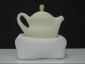 Yellow teapot in a pillow, 2007